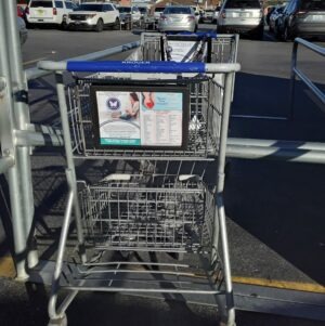 photo of Kroger cart with prevention info